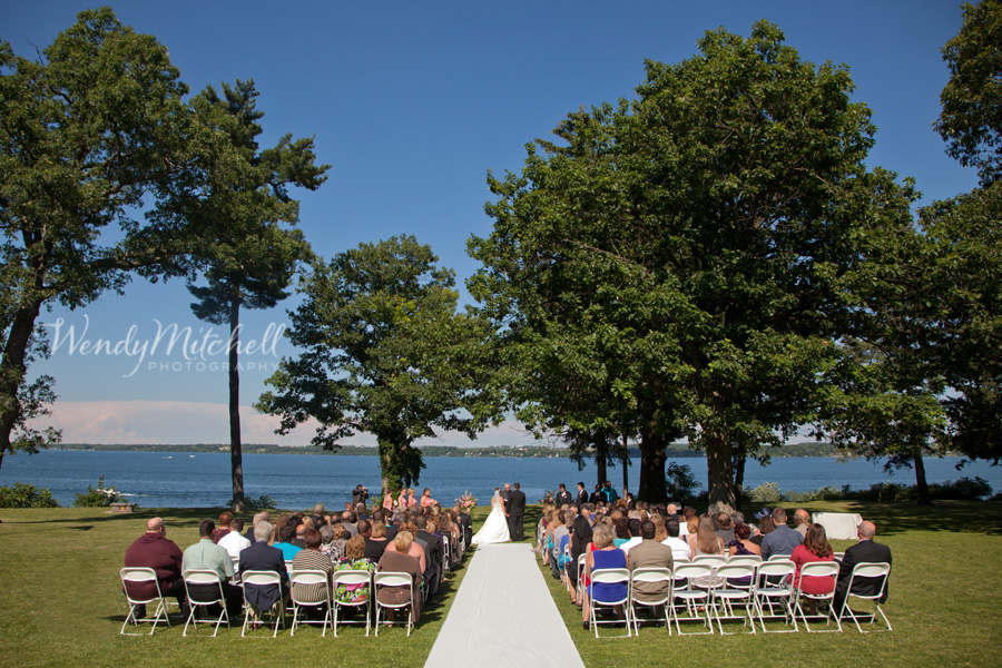 A wedding ceremony at Belhurst Castle on the shore of Seneca Lake in NY