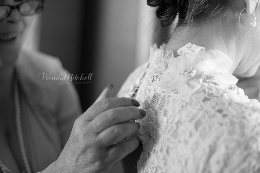 Bride's mom helping button the top of her lace dress | Buffalo Wedding Photography | Wendy Mitchell Photography
