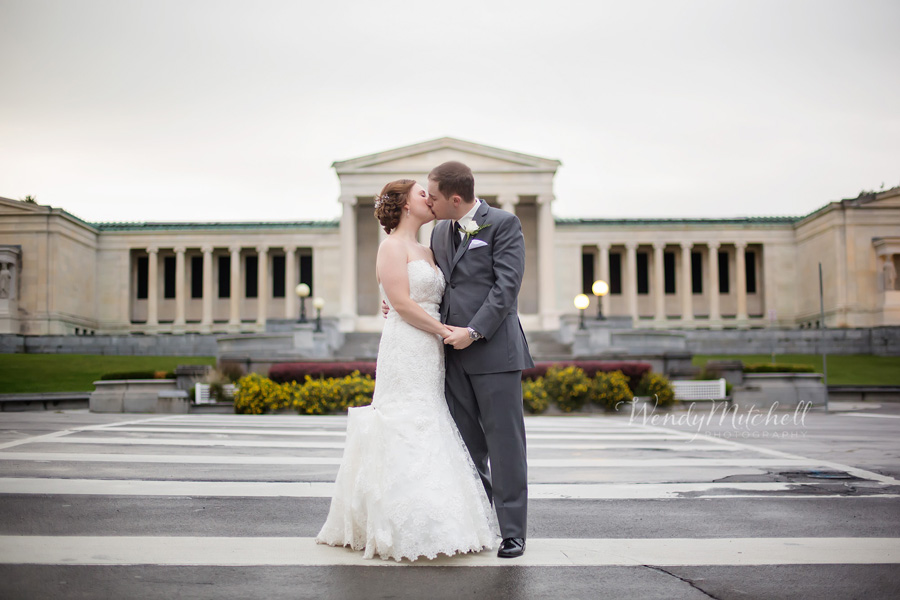 Bride Groom Kissing In Front Of Albright Knox Art Gallery
