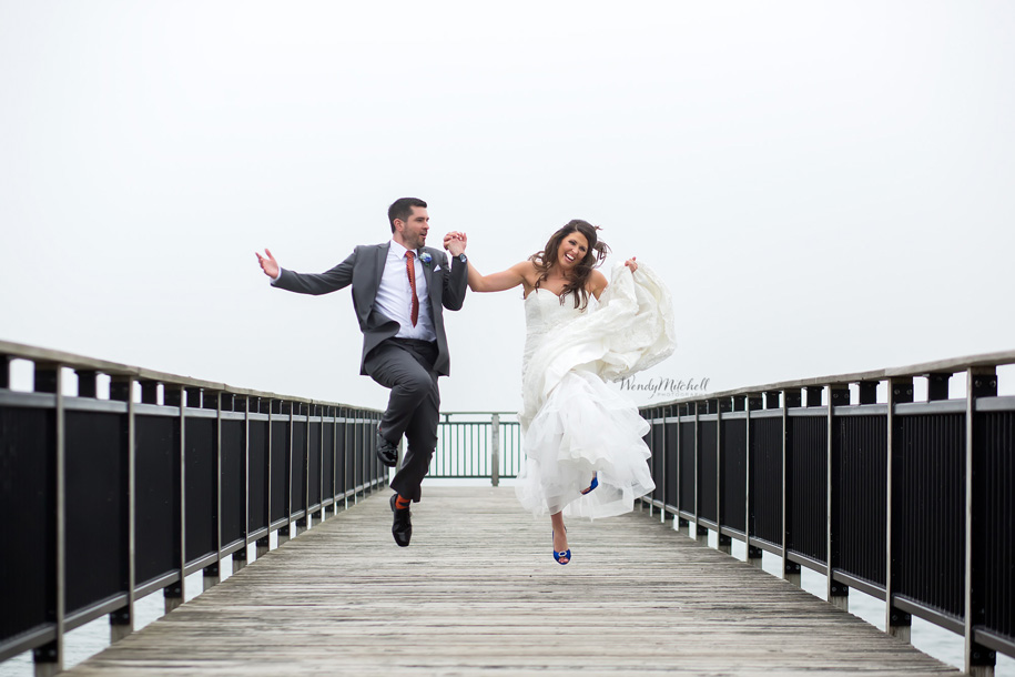 Bride & Groom running & jumping on Gallagher Pier on a foggy day | Buffalo Wedding Photography | Wendy Mitchell Photography