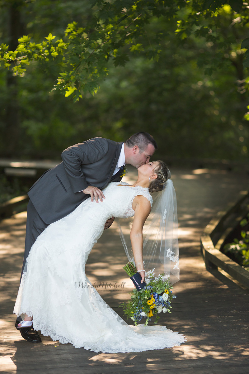 Bride and Groom kissing on wooden walkway at Timberlodge at Arrowhead | Buffalo Wedding Photography | Wendy Mitchell Photography