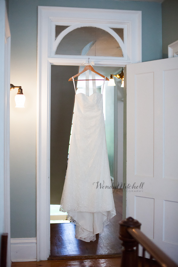 Bride's dress hanging in doorway at RED House Cassadaga | Wendy Mitchell Photography