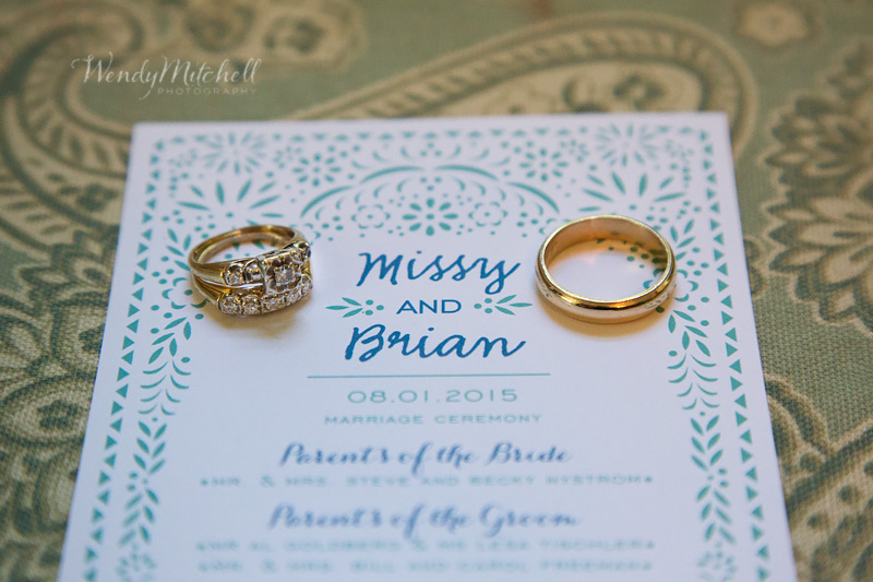Bride & Groom's yellow gold wedding rings on their wedding program | Wendy Mitchell Photography