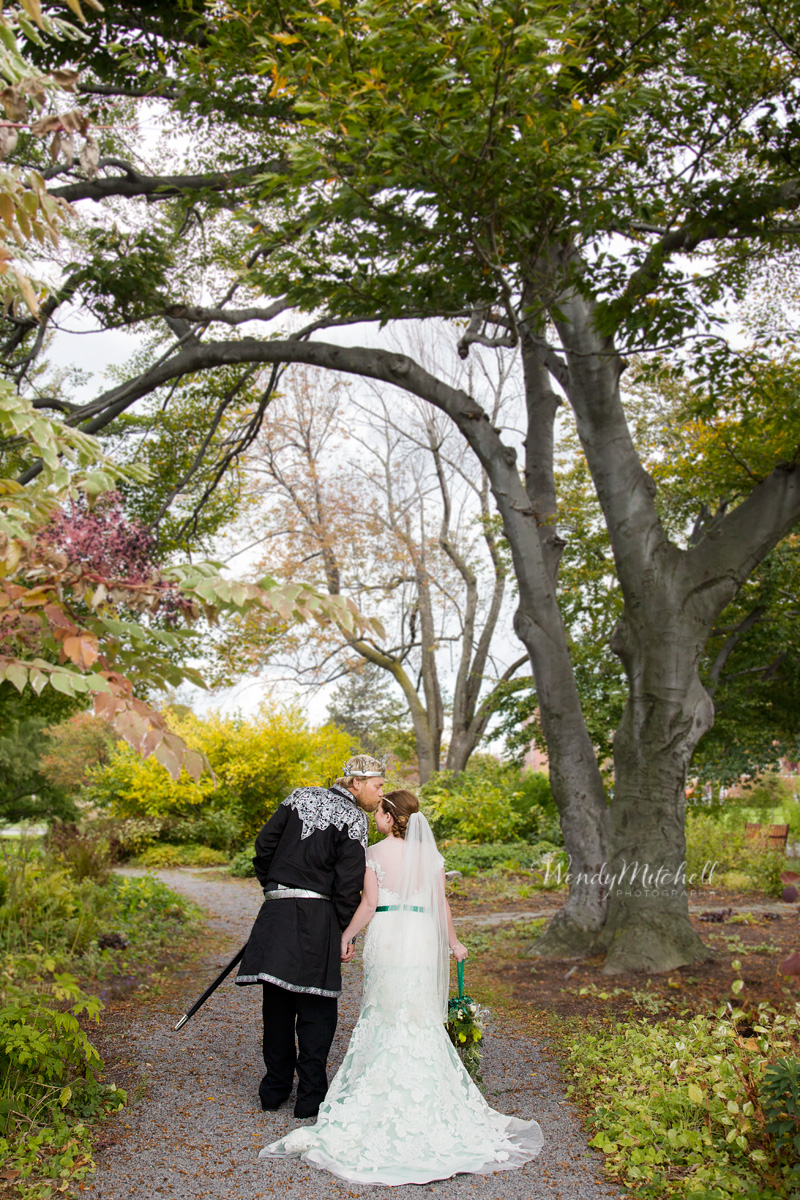 Bride U0026 Groom Kissing As They Walk Down A Path | Buffalo Botanical Gardens  Wedding |