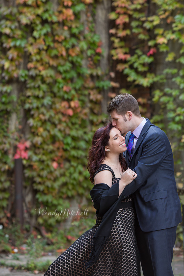 Engaged couple in front of fall ivy | Buffalo Engagement Photography | Wendy Mitchell Photography