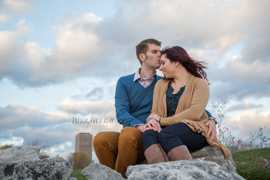 Engaged couple sitting on the rocks at Wilkeson Pointe | Buffalo Engagement Photography | Wendy Mitchell Photography
