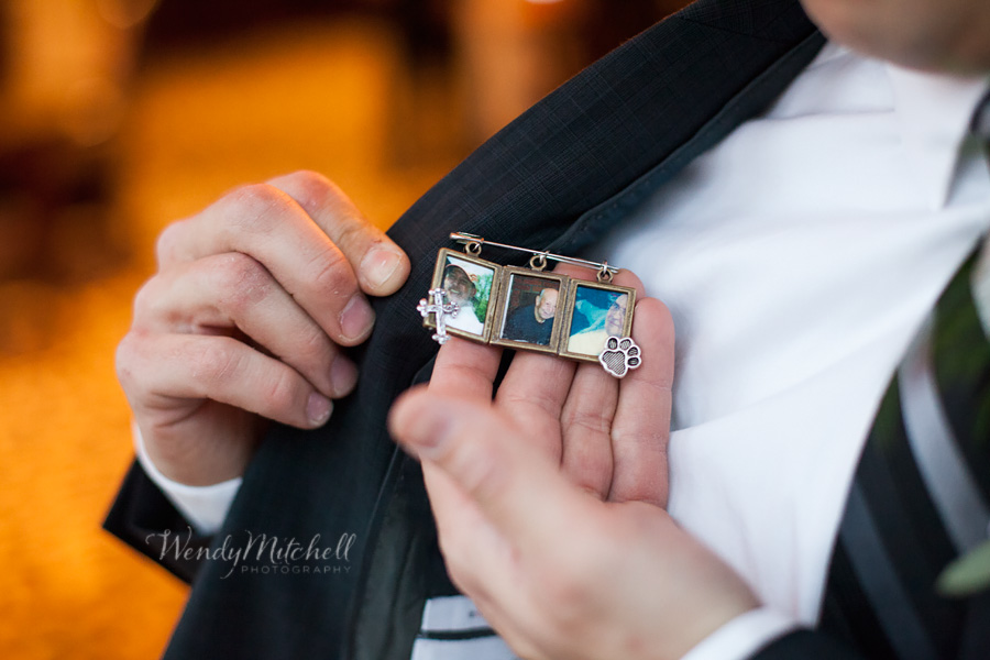The bride gave the groom a handmade pin holding charms of their fathers | Mansion on Delaware | Wendy Mitchell Photography