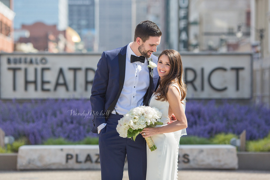 Bride & Groom in front of Buffalo Theatre District sign on Main St | Buffalo Wedding Photography | Wendy Mitchell Photography