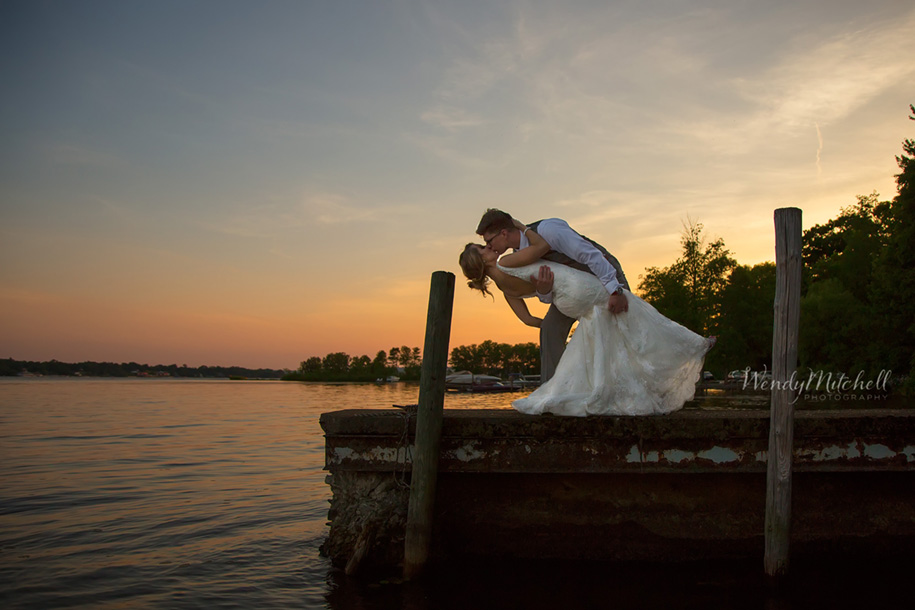 Bride & Groom kissing on a dock at sunset | Chautauqua Lake Wedding | Wendy Mitchell Photography