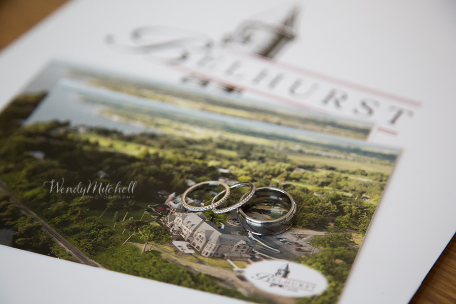Bride & Groom's wedding bands on top of a photo of Belhurst Castle | Belhurst Castle Wedding | Wendy Mitchell Photography