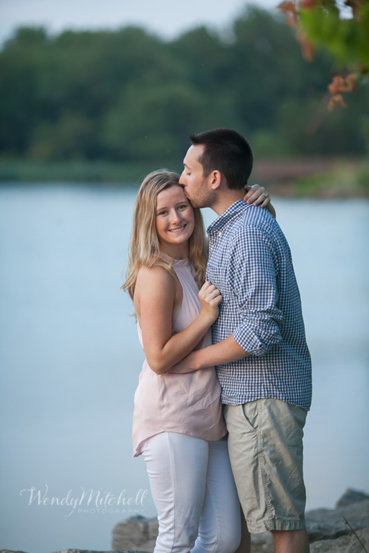 Engaged couple next to lake | Buffalo Outer Harbor | Wendy Mitchell Photography