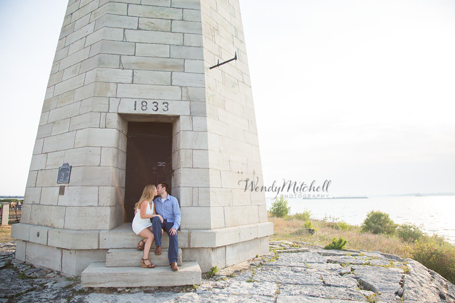Engaged couple kissing in doorway of lighthouse | Buffalo Outer Harbor | Wendy Mitchell Photography