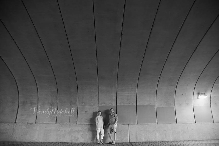 Engaged couple under a concrete overpass | Buffalo Outer Harbor | Wendy Mitchell Photography