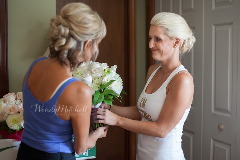 Bride & her mom seeing her bouquet | Buffalo Wedding Photography | Wendy Mitchell Photography