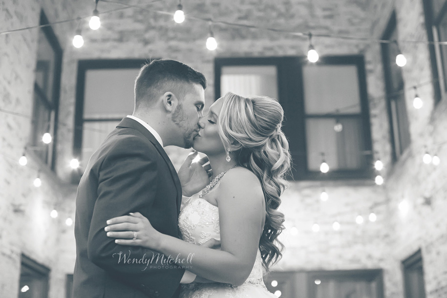 Bride & Groom kissing at Hotel Lafayette Greenhouse Room outdoor courtyard | Buffalo Wedding Photography | Wendy Mitchell Photography